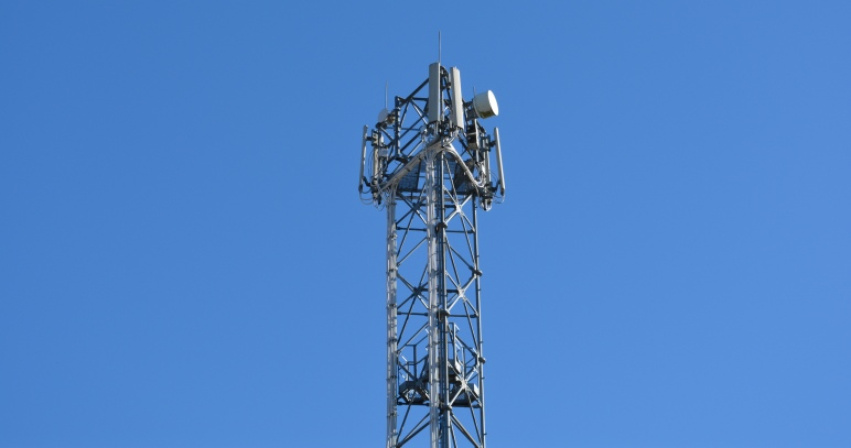 Mobile phone mast with blue sky